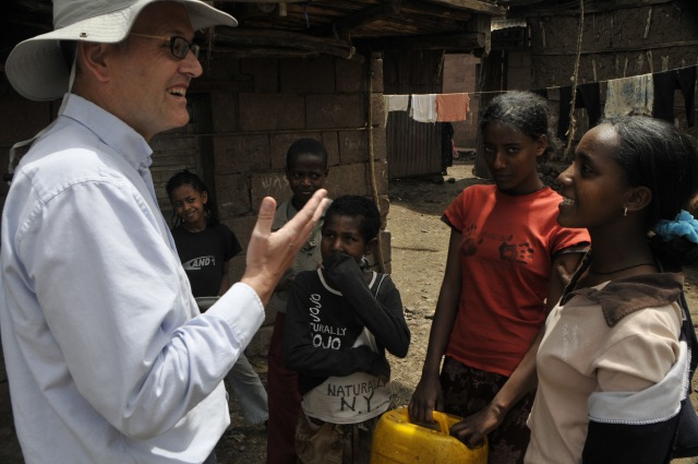 The late Dr Mark Goodwin talking to Ethiopian farmers and children